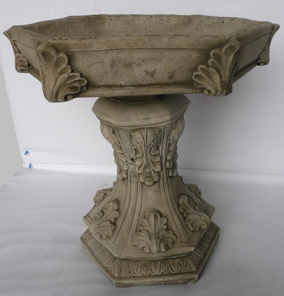 Bird bath with leaves engraved on column