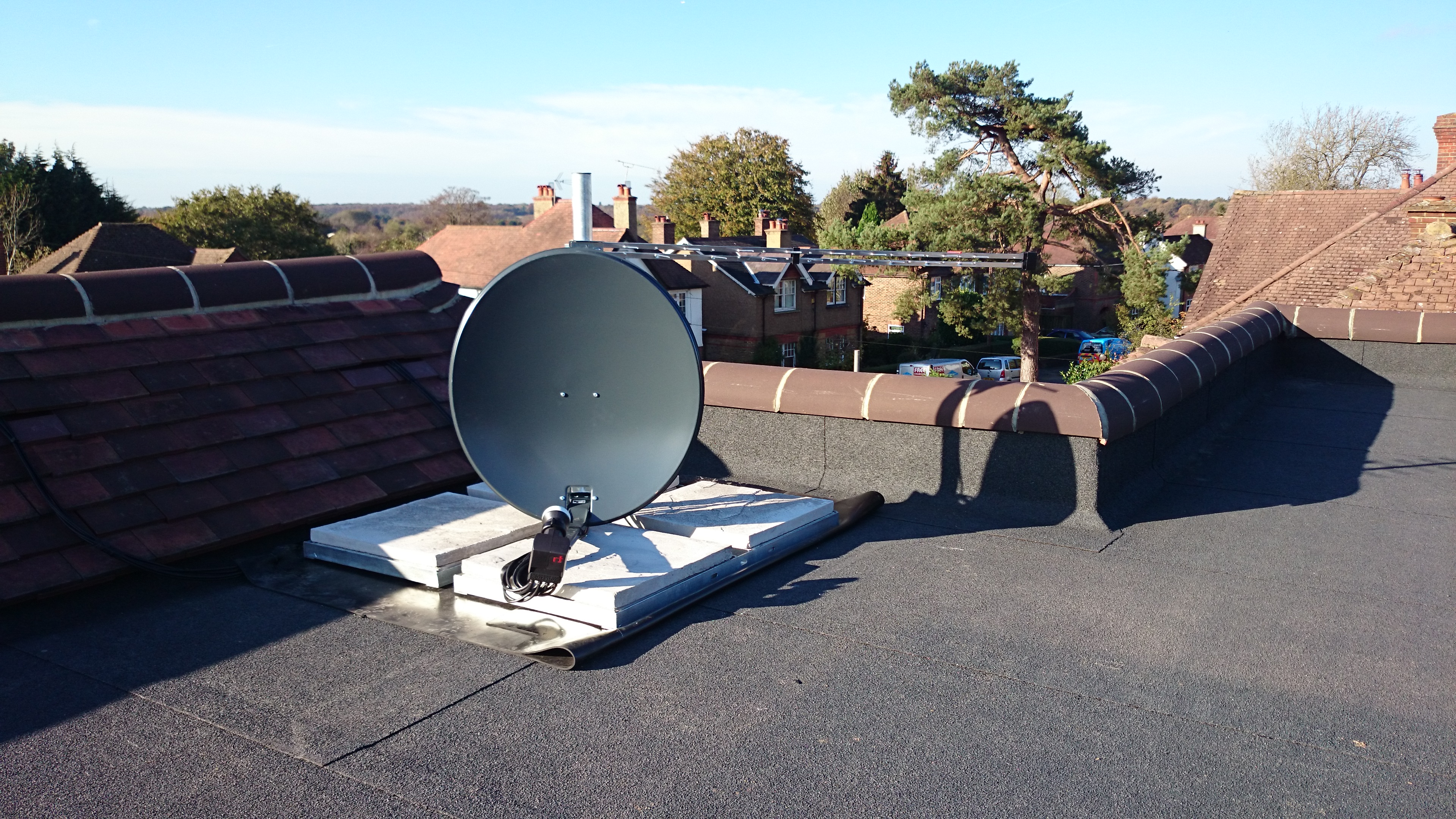 The client's brief was to have multiple SkyHD receivers and TV. Antennas not visible from street.