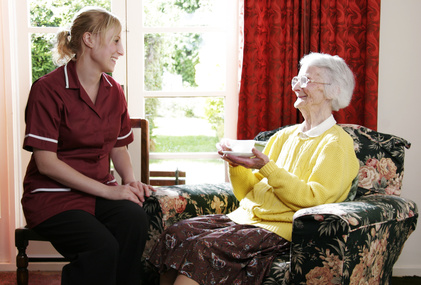 A member of staff chatting with a resident