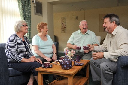 A group of residents meet over a cup of tea