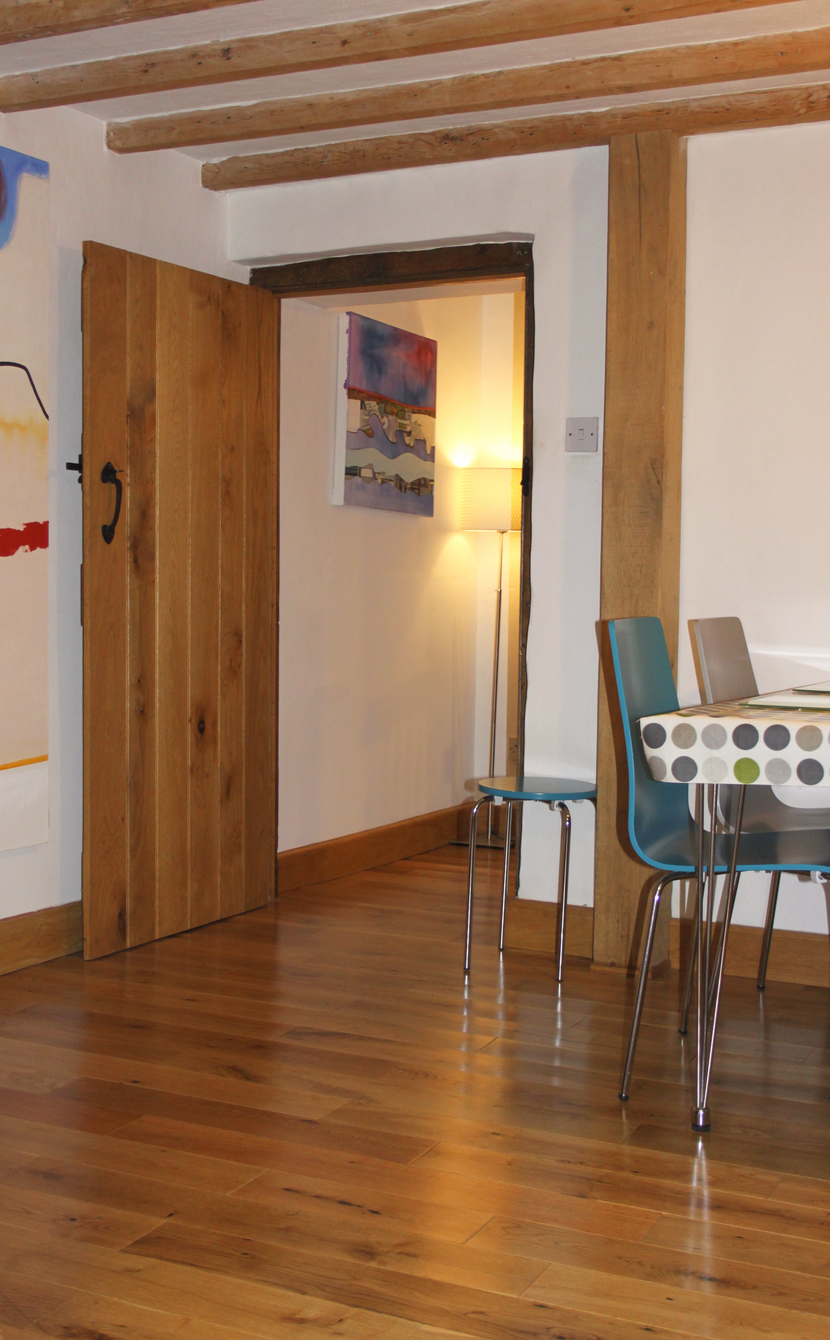 H.T.Hughes provided the beautiful solid oak floor and ledge and brace door with wonderful finish