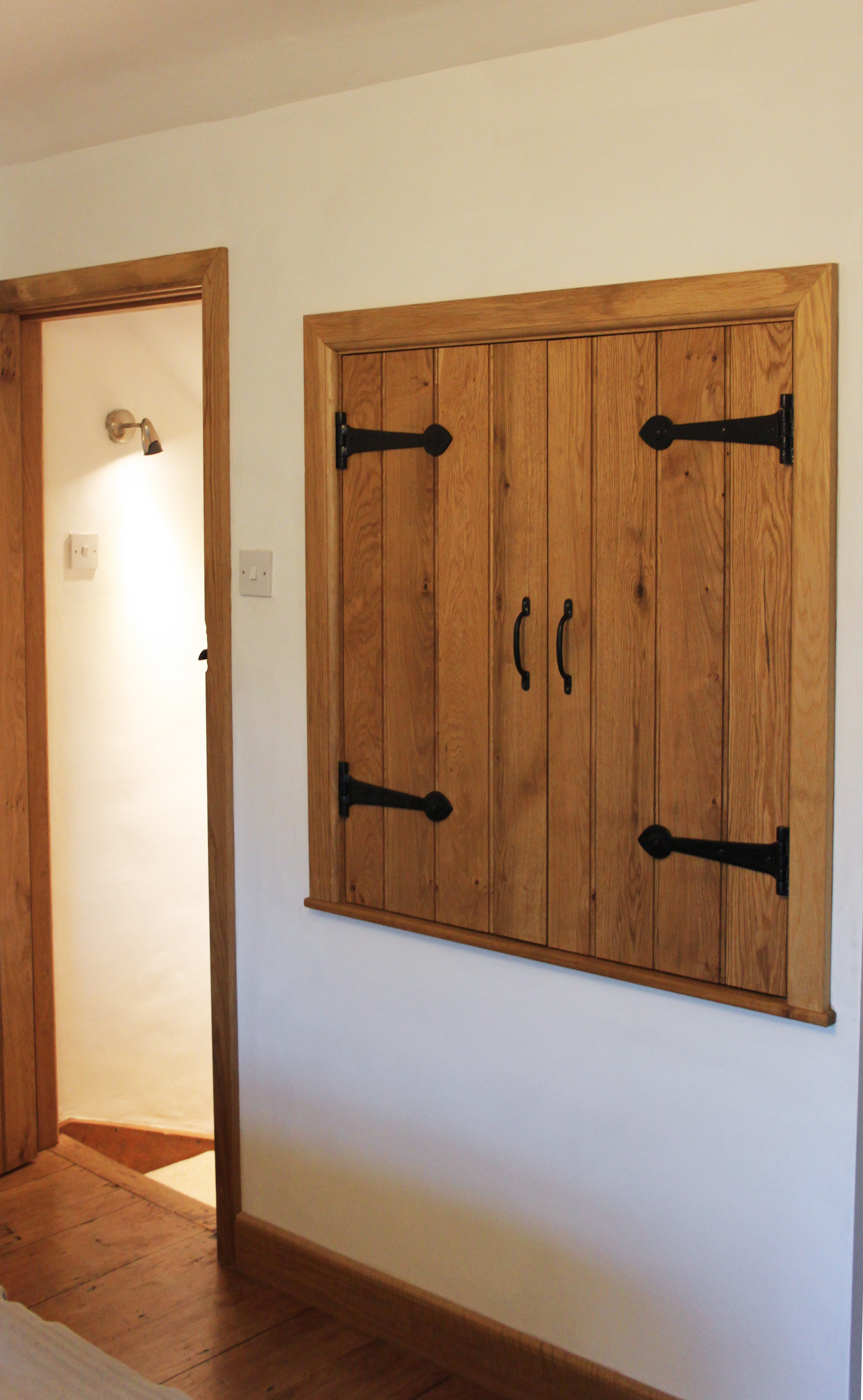 A beautiful period property in North Wales had custom made brace and ledge solid oak cupboard