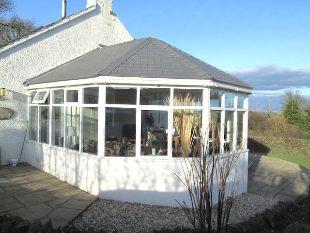 A conservatory with a new roof by Scott Widdowson Roofing and Joinery