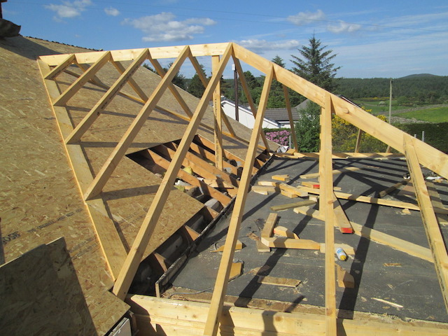 Roof conversion being built to extend the size of a house