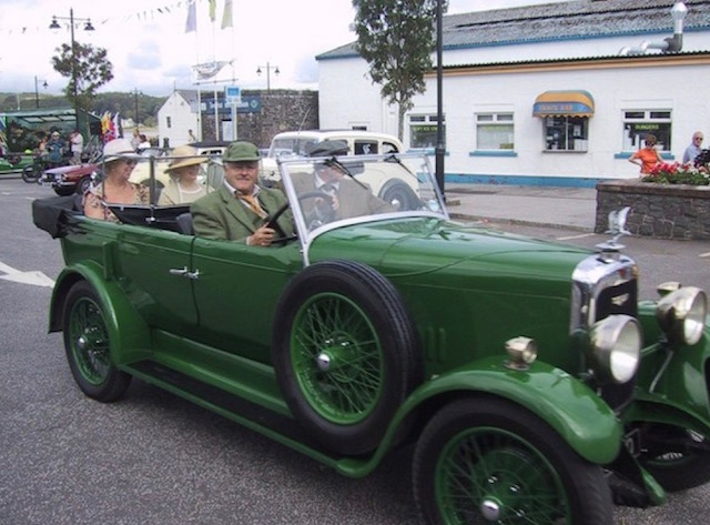 Green Rolls Royce being driven at a classic car event in Kirkcudbright