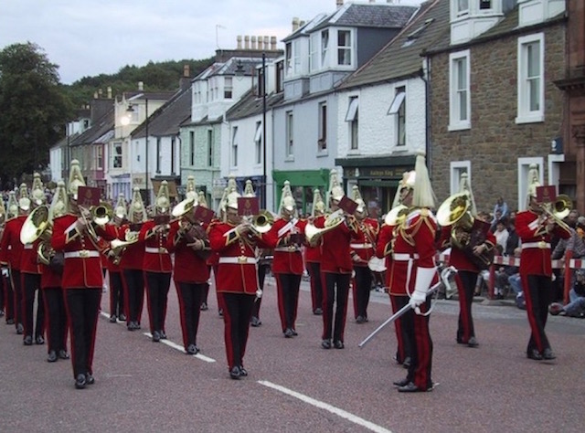 A brass band in splendid regalia performing at one of the Summer Festivities events in Kirkcudbright