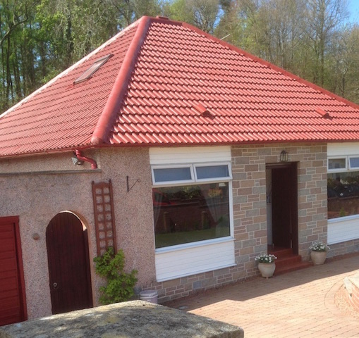 A lovely new moss resistant roof coating on a bungalow in Ayrshire