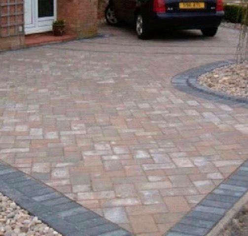 Block pave driveway in terracotta colour with black edgings