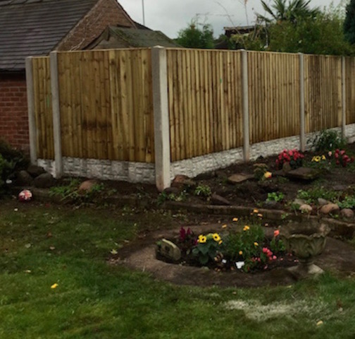Wooden fencing with concrete posts and base